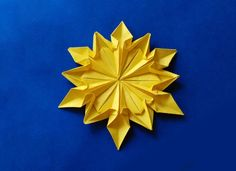 Origami 12 petals flower. This is absolutely beautiful and a wonderful decor when made on silky/gloss paper.
