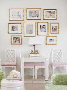 Family room gallery wall. Greek key brass lamp, fretwork chairs and game table, gold bamboo frames, pink white fabric. Chinoiserie and palm beach chic. Sweet children's portraits!