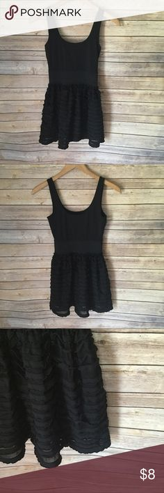 Miley Cyrus Black Ruffle Dress Miley Cyrus Maxazria Black Ruffle Dress. Good Preowned Condition. Made of 95% Polyester and 5% Spandex. Smoke Free And Pet Free Home. No Trades But Reasonable Offers Welcome. Bundle With Another Item And Save! Miley Cyrus Maxazria Dresses