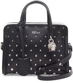 $987, Black Studded Leather Crossbody Bag: Alexander McQueen Mini Studded Padlock Zip Around Tote Bag Blackwhite. Sold by Neiman Marcus. Click for more info: https://lookastic.com/women/shop_items/73712/redirect