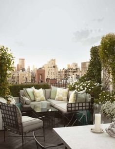 Patio gray mint cushions iron furniture white flowers city view.  Balcony.  Urban. http://cococozy.com