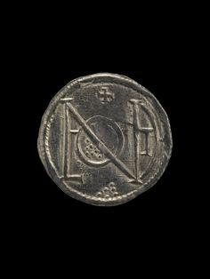 Silver coin (obverse) from Anglo Saxon Vale of York Viking Hoard. (British Museum)