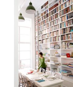Amazing book case with ladder, in the home of Diane Bergeron, interior designer. Via Design Files.
