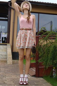 White ankle socks with brown leather sandals with heels, little flowers skirt with pink debardeur