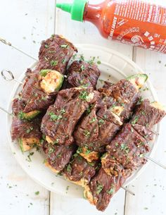 Sriracha steak-wrapped jalapeno poppers - Jalapeño Poppers are filled with cheese and bacon, then wrapped in sriracha marinated steak and grilled on skewers for the ultimate meaty, cheesy meal! Slow Carb Recipes, Beef Steak Recipes, Cheesy Recipes, Cooking Recipes, Healthy Recipes, Grilled Recipes, Cooking Time, Quick And Easy Appetizers, Easy Appetizer Recipes