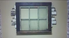 Idea for a blank wall...Old, reclaimed cypress window with heart-pine casing and reclaimed siding -  Built for an office in downtown New Orleans.