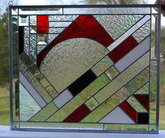 Stained glass Panel with Diamonds, Squares, Rectangles, Bevels Red Black White Iridescent Glass by R2P2Designs on Etsy https://www.etsy.com/listing/290509719/stained-glass-panel-with-diamonds