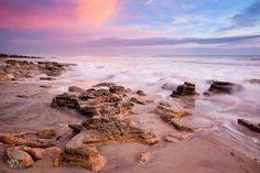 A colorful sky greets visitors at sunrise at Washington Oaks State Park's coquina beach in Northeast Florida.