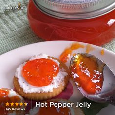 "Hot Pepper Jelly | ""I made this recipe and it tastes just like I remember from the farmer's market in Birmingham as a kid. I think many are confused by the name because it's called jelly. The hot pepper jelly we had as kids was never set up. It's just a syrup like consistency you pour over cream cheese and eat until you're sick with crackers. The sweet and hot at the same time is so addictive."""