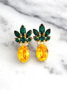 Pineapple Earrings, Pineapple Jewelry, Yellow Emerald Crystal Swarovski Earrings,Trending Jewelry, Swarovski Earrings, Pineapple Studs  ♥IF YOU WANT THE BEST CHOSE THE ORIGINAL ♥ Top Quality Materials ♥ Excellent Customer Service ♥ Swarovski Authentications Tags ♥ Petite Delights is an Official SWAROVSKI® Branding Partner Official Swarovski Elements® Partner Made with real genuine high quality Austrian Swarovski ©Crystal . Our brand is legally licensed & authorized By Swarovski Company f...