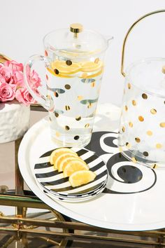 Let's dish. Our raise a glass collection (crafted in durable melamine that won't chip or crack) is the first thing we grab when guests are on their way. We love when party-goers discover the witty turns of culinary phrase and graphic patterns hidden around the snacks we're serving  Holds 2 quarts BPA-, phthalate-, and lead-free Handwash recommended For cold beverages only