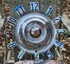 Hey, I found this really awesome Etsy listing at https://www.etsy.com/listing/260032701/antique-oldsmobile-hubcap-clock-1950