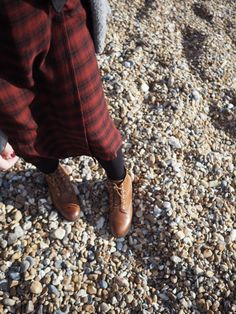 Red check dress from Zara paired with opaque tights and brown lace up boots from Boo hoo. Perfect Autumn outfit for a stroll along a beach in the fall | Hannah and The Blog