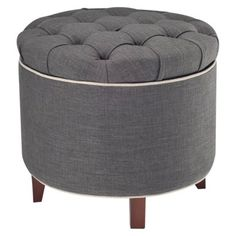Storage ottoman with a tufted top. Product: Storage ottoman Construction Material: Wood and linen Color: Gray Features: Button-tufted lid Plush place to rest your feet onLift lid for interior storage Dimensions: H x Diameter Tufted Storage Ottoman, Fabric Ottoman, Ottoman Bench, Ottoman Ideas, Storage Footstool, My Living Room, Living Room Furniture, Accent Furniture, Chairs
