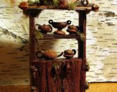 A lovely little bark kitchen hutch with lots of charming details including a miniature acorn teapot and cups. - inspiration only - this is a custom order item on Etsy ******************************************** PandoraJane via Etsy - t√ Fantasy Play, Fairy Village, Fairy Tree, Kitchen Hutch, Fairy Furniture, Twig Furniture, House Furniture, Fairy Garden Houses, Fairy Garden Accessories