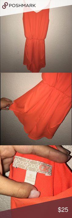 NWOT neon orange GB romper Gianni Bini cross back romper. Perfect condition and never been worn! Super cute summer outfit Gianni Bini Dresses