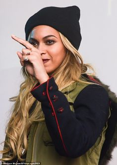 Stunning: Beyonce Knowles looked stunning in her khaki jacket and black beanie hat