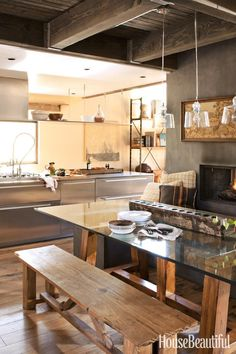 Modern Rustic Chic Kitchen & Dining Area next to fireplace. Lovely warm wood tones on floors: Best Kitchens of 2012 - Top Kitchen Designs - House Beautiful