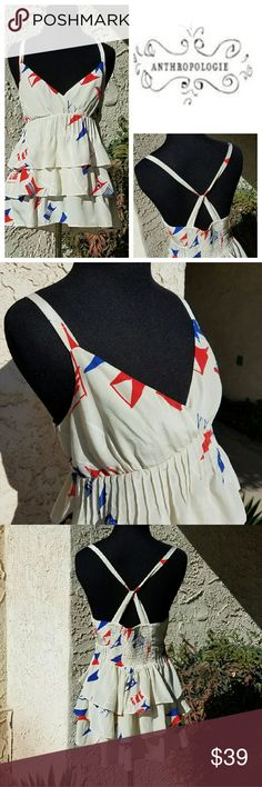 Anthropologie Printed Layer Crossback Top Cream color fabric with blue and red shapes. Fabric is layered below bust. Elastic at the mid back. Lovely and feminine blouse. (We?Vera brand from Anthro) Anthropologie Tops