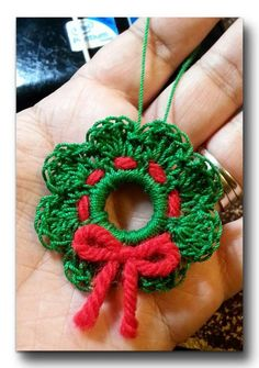 Best 12 Create an easy Crochet Wreath Ornament. Crochet ornaments are such wonderful free Christmas patterns. Crochet Christmas Wreath, Crochet Wreath, Crochet Tree, Crochet Christmas Decorations, Crochet Ornaments, Crochet Crafts, Crochet Yarn, Yarn Crafts, Crochet Flowers