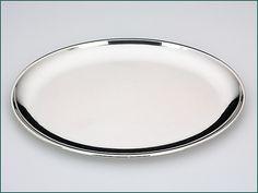 Zilveren dienblaadje n.o.v. Christa Ehrlich uit 1934 - Hollands zilveren ovaal dienblaadje n.o.v. van Christa Ehrlich (CE Blad nr. 18) 2e gehalte Afmeting 26 x 19,6 cm Gewicht 265 gram Jaarletter Z = 1934 Meesterteken Zilverfabriek Voorschoten - Voorschoten