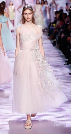 Blush pink dress with white flowers by Georges Chakra.    Georges Chakra is a Beirut-based Lebanese haute couture fashion designer.