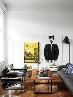 double Marcel Breuer wassily chairs with wood & metal coffee table + gray couch & print pillows + bold art | via Handsome Sexy Man Rooms ~ Cityhaüs Design