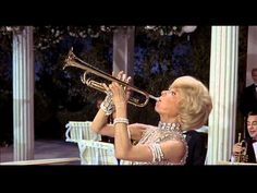 """Jazz Baby"" by Carol Channing. Taken from one of my favorite movies, ""Thoroughly Modern Millie."" Here, Channing demonstrates why she was such a major, Broadway sensation. Her version of  the 1920's hit is silly fun (1967) Interesting factoid: This song was adapted as the theme for ""Wheaties"" cereal commercials in the 1950's."