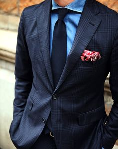 Men's dark blue suit with subtle blanket plaid pattern