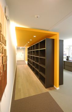 "Semi-hidden storage ""Room"" corporate office - shelves for material binders and samples"
