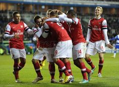 Santi gets mobbed after scoring his first #Arsenal hat-trick, in the 5-2 win at Reading.