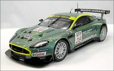 Review : SCX  DBR9 - SlotCarIllustrated.com - Aston Martin Dbr9, Aston Martin Models, Rc Vehicles, Car Images, Rc Cars, Fast Cars, Toys, Activity Toys, Games