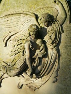 Angel escorting a woman and child.