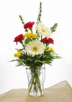 Let us arrange a smile for you, with our fresh spring flowers!
