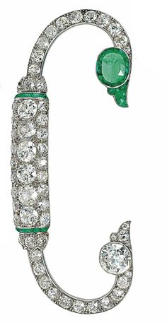 AN EMERALD AND DIAMOND BROOCH, BY CARTIER  Of fibula design, the pavé-set old-cut diamond curving panel with calibré emerald line detail, to a fluted emerald or diamond terminal at either end, circa 1920, French marks for platinum, 9.1cm wide, original maker's case Signed Cartier, Paris, no.C8082