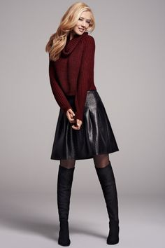 Red sweater with black leather skirt (a-line) and black boots