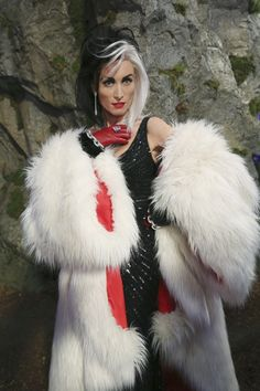 Cruella @ Maleficent and bens wedding in her new wicked coat