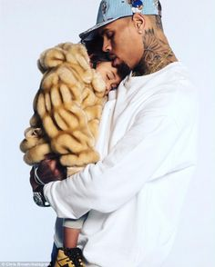 Single father-of-one: Chris Brown shared a touching snap of himself cradling daughter Royalty with his combined 74.3M followers on social media Sunday