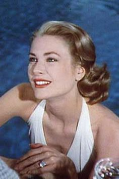 After Prince Rainer III of Monaco proposed to Grace Kelly with a Cartier eternity band filled with rubies and diamonds, he commissioned them to make a much bigger one once they were in the USA to match the bigger, flashier rings other stars wore. She wore this 10.47 carat emerald cut diamond with a baguette cut diamond either side in the film 'High Society', using it as a prop when her character got engaged.