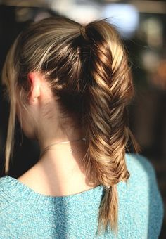 "A ponytail and a fishtail? It's like the Frankenstein of fantastic hairstyles, otherwise known as the ""ponyfish."" Just make your typical high pony, and fishtail into greatness."