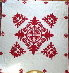 Early-mid 20th century red and white Hawaiian style applique quilt