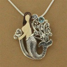 Sterling Silver Fossilized Mammoth Tusk Mermaid with Blue Topaz & Rainbow Moonstone Necklace.  $249.00