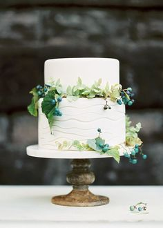 two tried white cake with porcelain berry vine. Carlos Hernandez