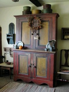 Awesome stepback cupboard in old paint.