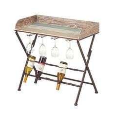 Stow your favorite vintages and serve evening cocktails with this handsome wine table, showcasing a multicolored tray top, storage space for 5 bottles, and a. Nautical Table, Wine Table, How To Distress Wood, Dot And Bo, Engineered Wood, Storage Spaces, Beautiful Homes, Home Goods, Sweet Home