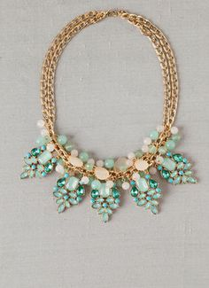 Francesca's ZURICH JEWELED STATEMENT NECKLACE  Create a stir with our Zurich Jeweled Statement Necklace! Jeweled medallions hang beneath pastel beads on a golden chain to create this elegant statement necklace. Finished with a lobster claw clasp. #Jewelry #Necklace #Fashion #Francescas