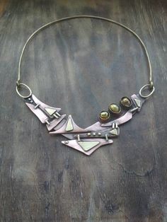 I made this unusual necklace of copper, brass and pearl. The width of necklace - the height - about 3 Brass Necklace, Brass Jewelry, Jewelry Art, Golden Jewelry, Jewelry Ideas, Unusual Jewelry, Statement Jewelry, Handmade Necklaces, Metalsmith Jewelry