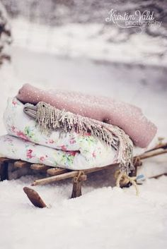 Kristín Vald, photographer. Sled, winter, blankets, quilts, throws, pink, snow