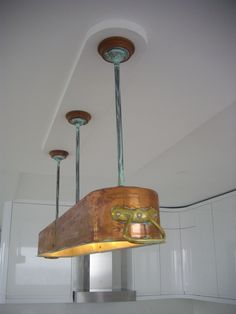 Over-kitchen island light made by one of our customers for a client using parts obtained from Lamps and Lights