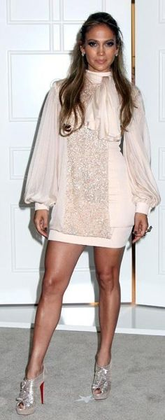 Who made Jennifer Lopez's purse, pink dress, jewelry and nude boots that she wore at Macy's on September 10, 2010? Shoes – Christian Louboutin  Dress – George Hobeika  Purse – Raven Kauffman  Jewelry – H. Stern